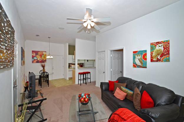 Homey Venetian Villas living room with spacious floor plan & breakfast bar