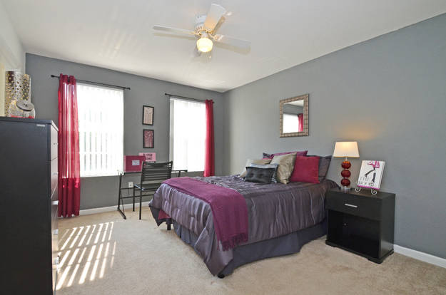 Spacious bedroom at The Preserve with oversized windows & plush carpet