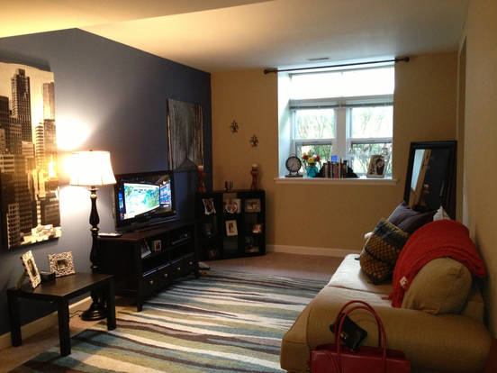 Intimate, carpeted Chesterfield living room