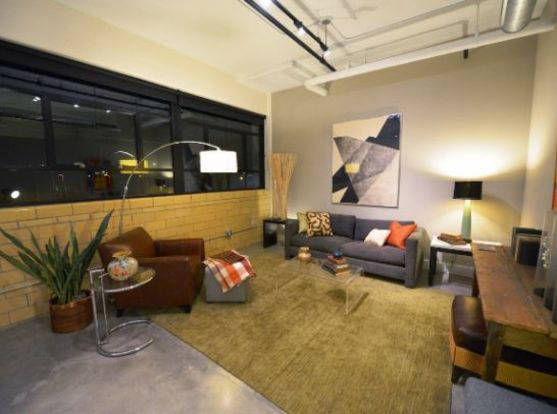 Spacious Laclede Lofts living room with exposed industrial details