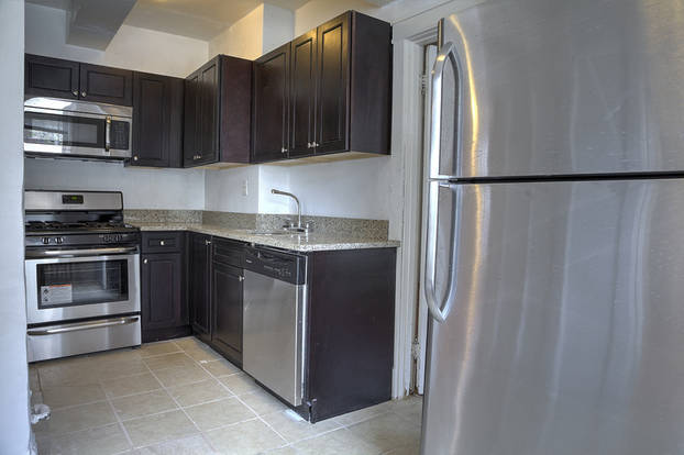 Well-designed Park Lane Kitchen with stainless steel appliances