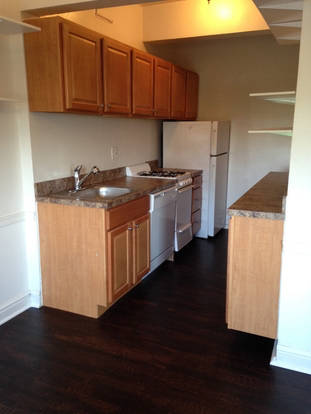 Intimate kitchen at The Saum with plank floors