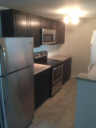 Intimate Park Lux Kitchen with Stainless Steel Appliances