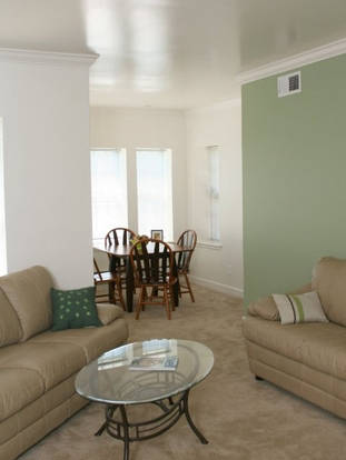 Bright Waterman Clara living room and dining space with large windows