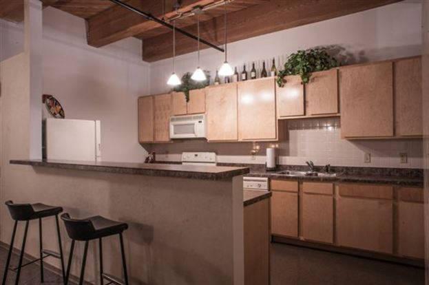 Conveniently designed Vangard Lofts Kitchen with breakfast bar