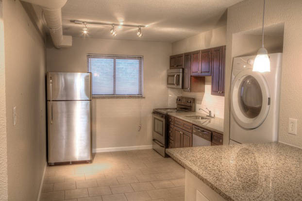 A contemporary Donatello building kitchen featuring stainless steel appliances