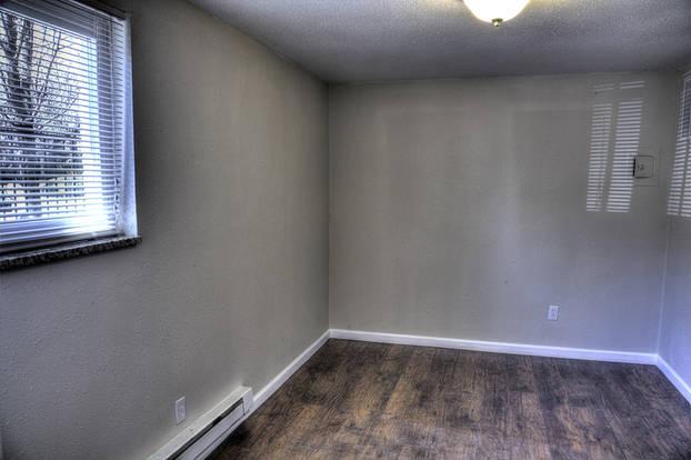 Intimate Michelangelo bedroom with classic floor moldings and hardwood floors